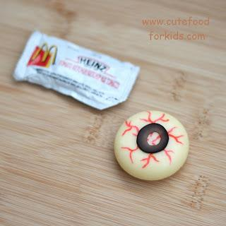 - Fill the centre of the olive with ketchup