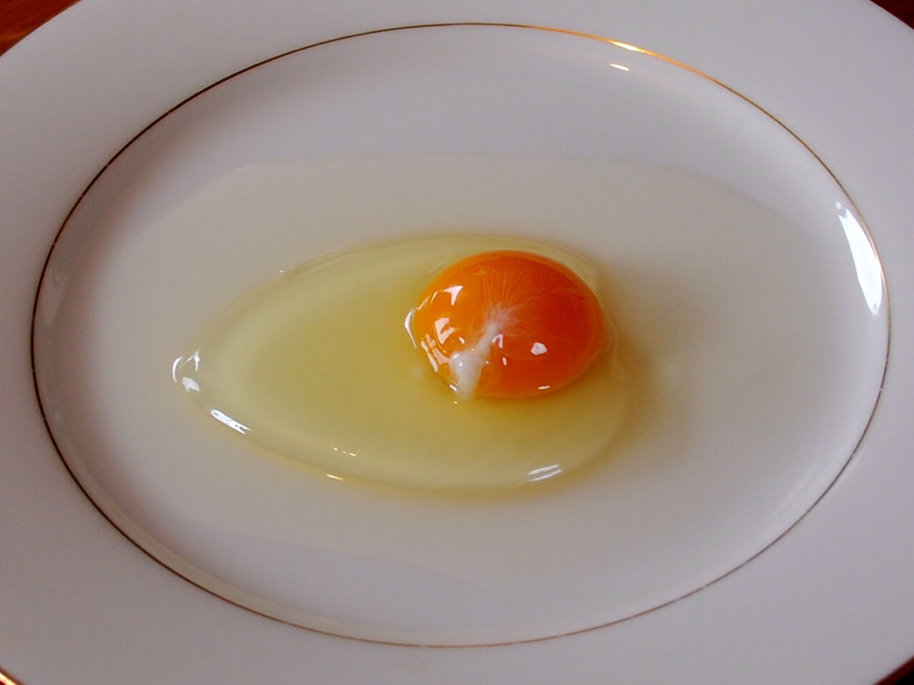 Raw egg helps the skin on your face. Separate the egg white and yolk. Whisk the egg white then rub all over your face and wait for it to dry. Rinse with cold water.