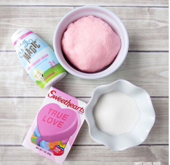 For this recipe, you will need:  -16 oz of powdered sugar (1/2 of a regular sized bag) -2 oz of cream cheese, softened to room temperature -Plain white sugar -Light corn syrup -Conversation Hearts -2 squeezes of Strawberry Cream Milk Magic (found at the grocery store or amazon)