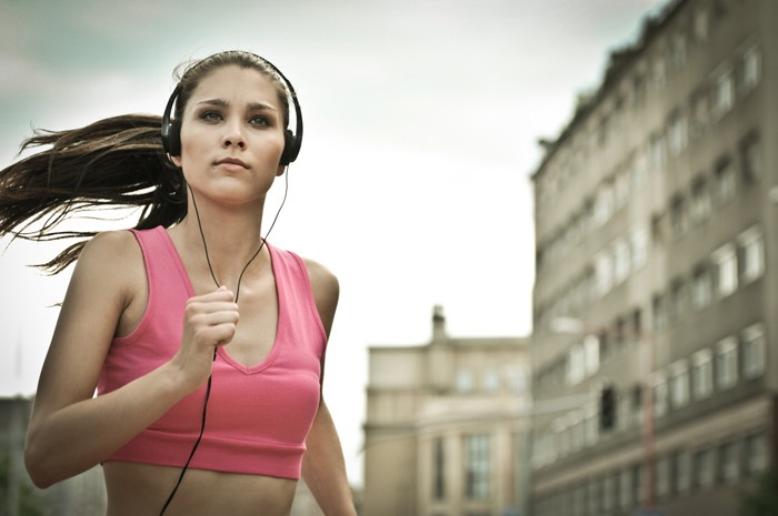 Running with music is a great was to get motivated to run but don't turn it up to loud so you can hear the cars.