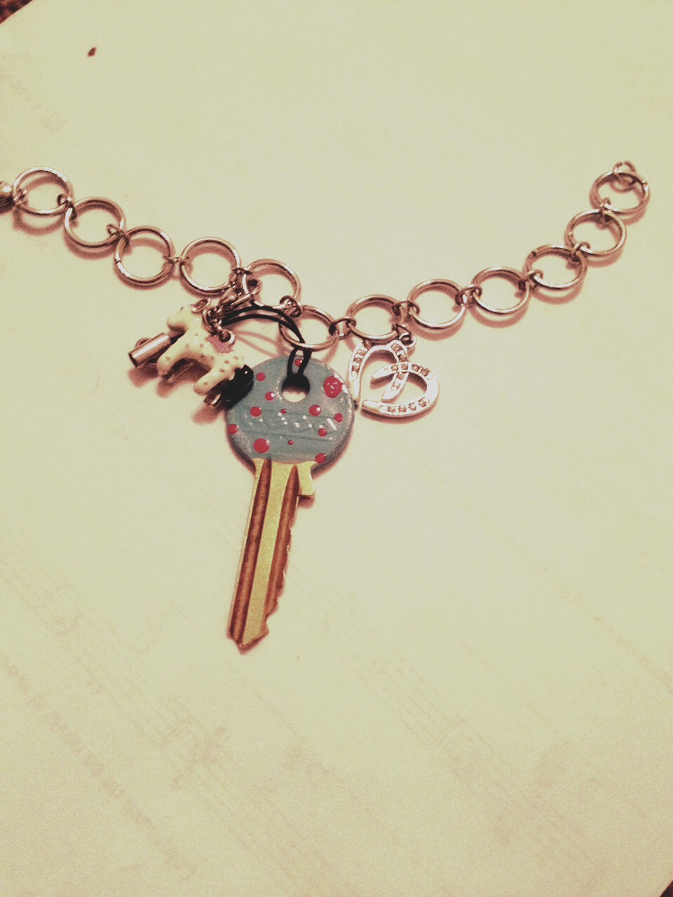 Now add your key using ribbon/string or what ever you can find to your bracelet and wear it with style. DONT FORGET TO LIKE AND SHARE :)