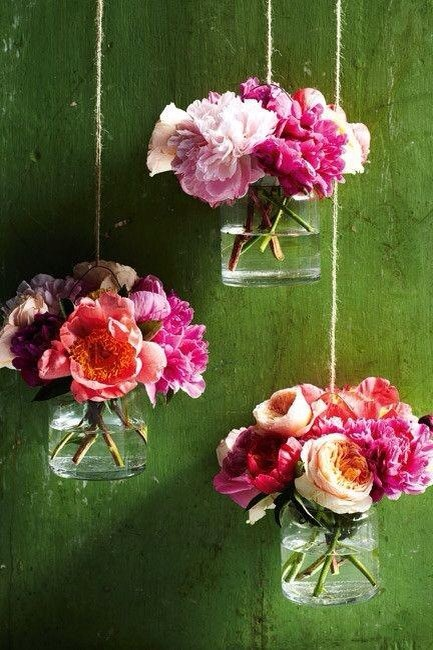 Hang jar with twine fill with water and flower. Pretty wall art.