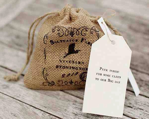 17. The Burlap Pouch    Fill a printed burlap pouch with little hints in accordance with your wedding theme (like seashells for a beach wedding).