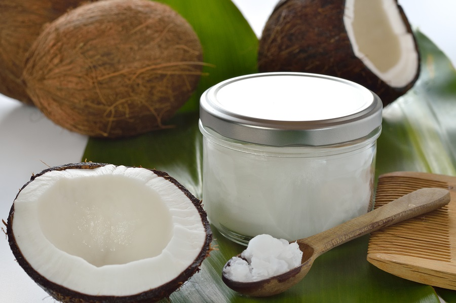 mix a cup of coconut oil in a bowl with coffee grounds