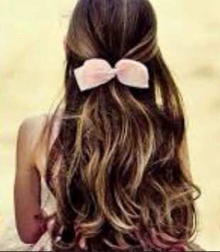 Simple curly hair with top half of hair clipped in a bow