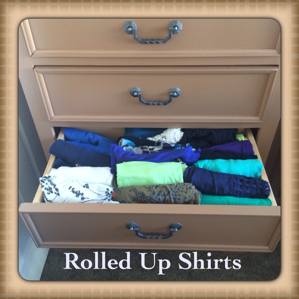 At my last house I had open shelves. If you didn't know rolling your t-shirts help save space in luggage. I just stuff all t-shirt in this drawers when I moved. Ugly right!!