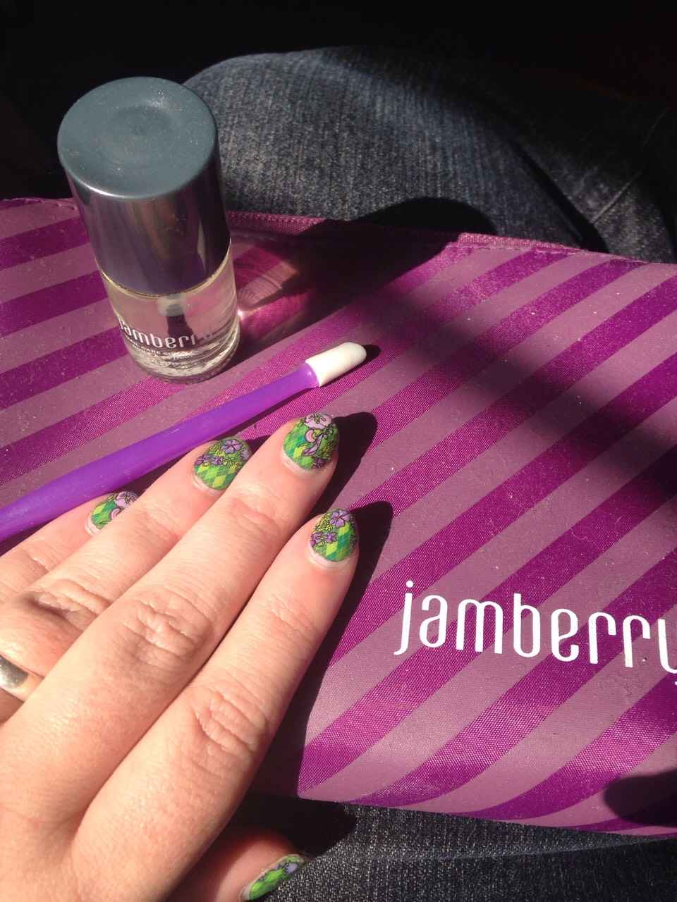 Step 1: using Jamberry cuticle oil, or any oil you have on hand, and a rubber cuticle pusher.