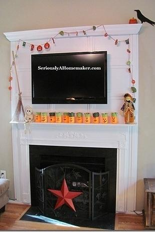 Hide your cords in trim.  This will make your television blend in seamlessly with your mantel and fireplace.