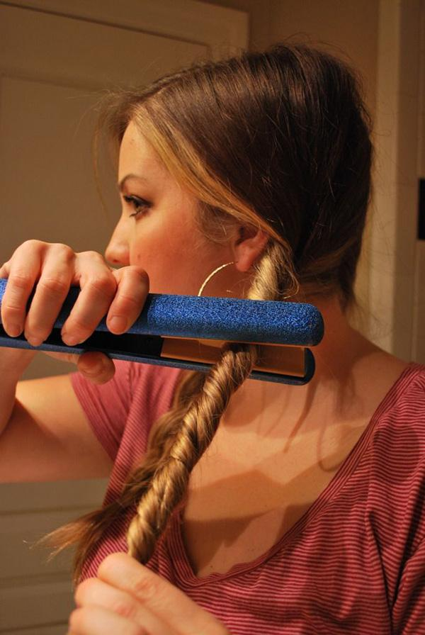 11. Get natural looking waves by twisting hair tightly, then running a flat iron over it.