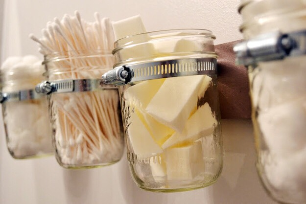 2. Bathroom Storage   Lovely Little Details / Via lovelylittledetails.com Get organized by stashing your bathroom beauty tools in a cool hanging mason jar storage piece.
