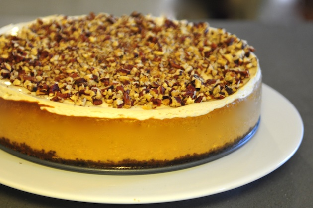 Ingredients:  *1/2 cup finely chopped pecans *1/3 cup butter, melted *2(8 ounce) packages cream cheese, softened *3/4 cup white sugar, divided *1 tsp vanilla extract *3 eggs *1 cup canned pumpkin *3/4 tsp ground cinnamon *1/4 tsp ground nutmeg