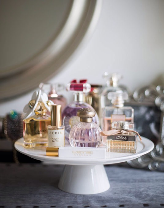 24.Display pretty fragrances on top of a cake stand.
