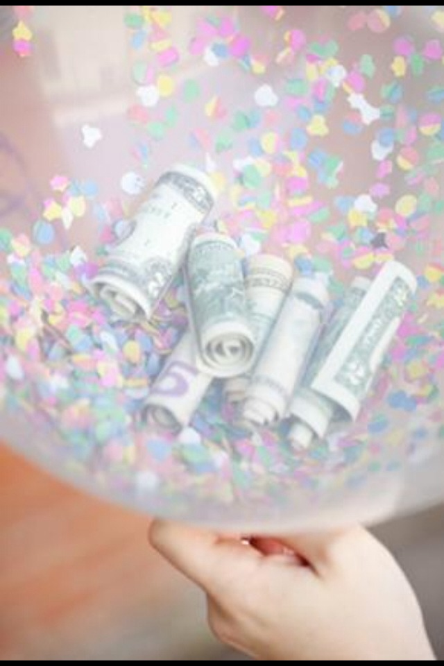 Blow up a balloon and fill with, confetti, sparkles and (best part😉) MONEY!!