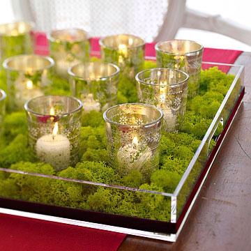 Merry moss  For a low centerpiece, fill a tray with moss and votive candles in holiday holders.