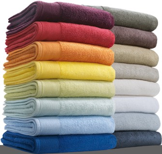 Drying your hair with a towel causes friction and it makes your hair frizzy. Try using a old T-shirt of yours to dry your hair.