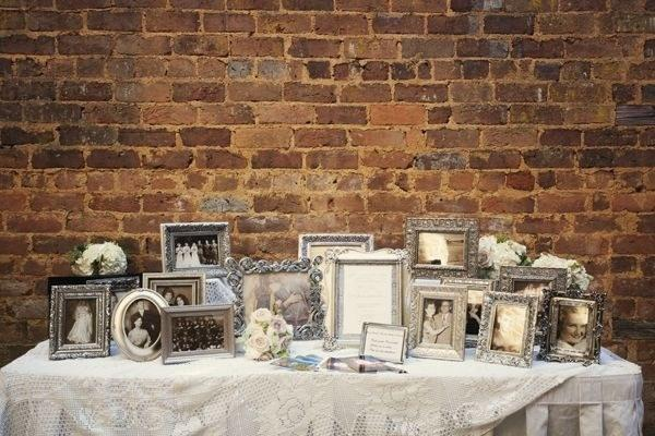 Put together a mismatched collection of frames to hold old photos for a wedding table.