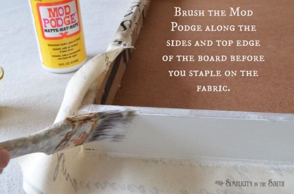 Flip the frame over and coat the top edge and sides of the frame. Smooth the fabric down, making sure it is taut. Then, staple along the inside edge.