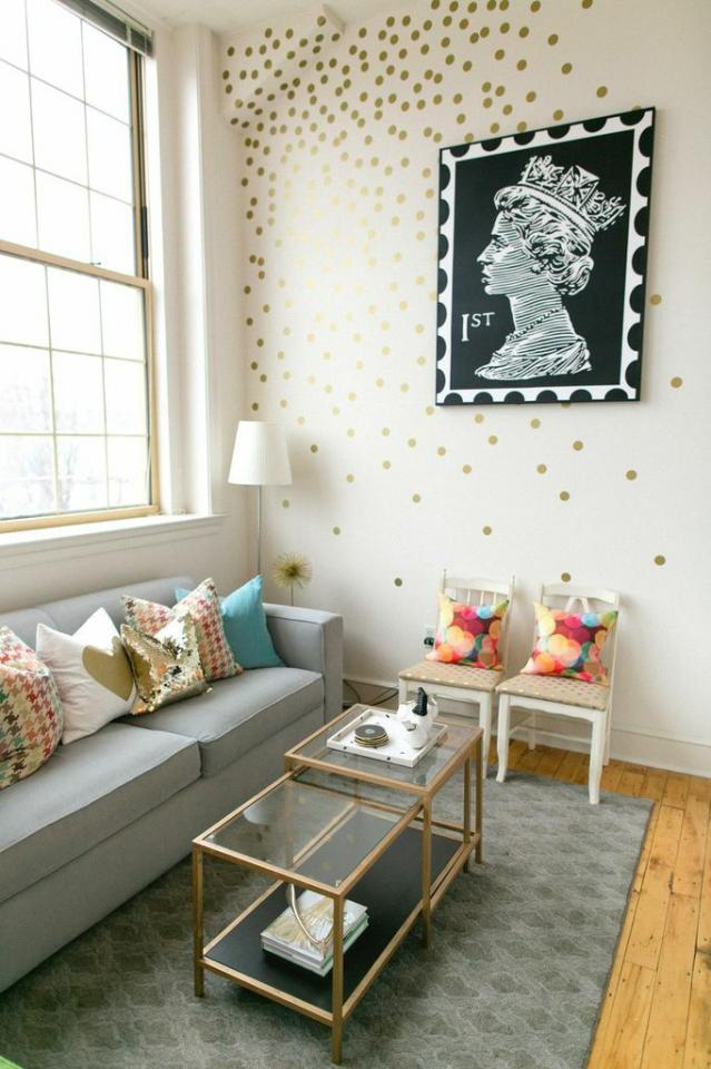 The Every Girl painted gold dots all over the accent wall of this living room. I love the way this looks–so fresh, fun, and sophisticated. And all you need is a stencil or stamp and some paint! Easy and inexpensive!