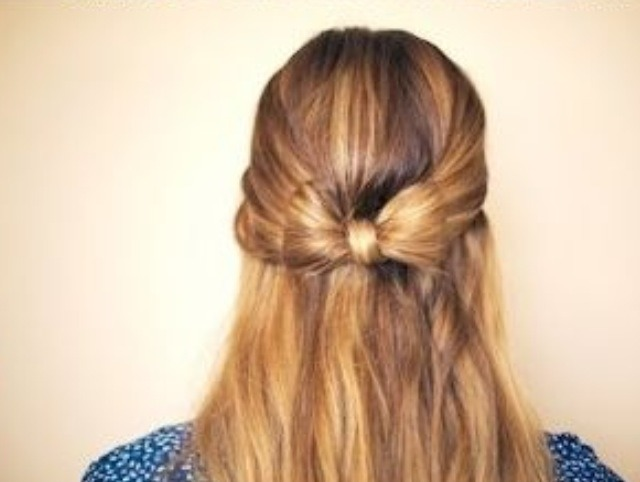 Take the little ponytail that was connected with your bow an wrap it around the space inbetween the two bow parts. Pin it down with a bobby pin and make sure it's hidden