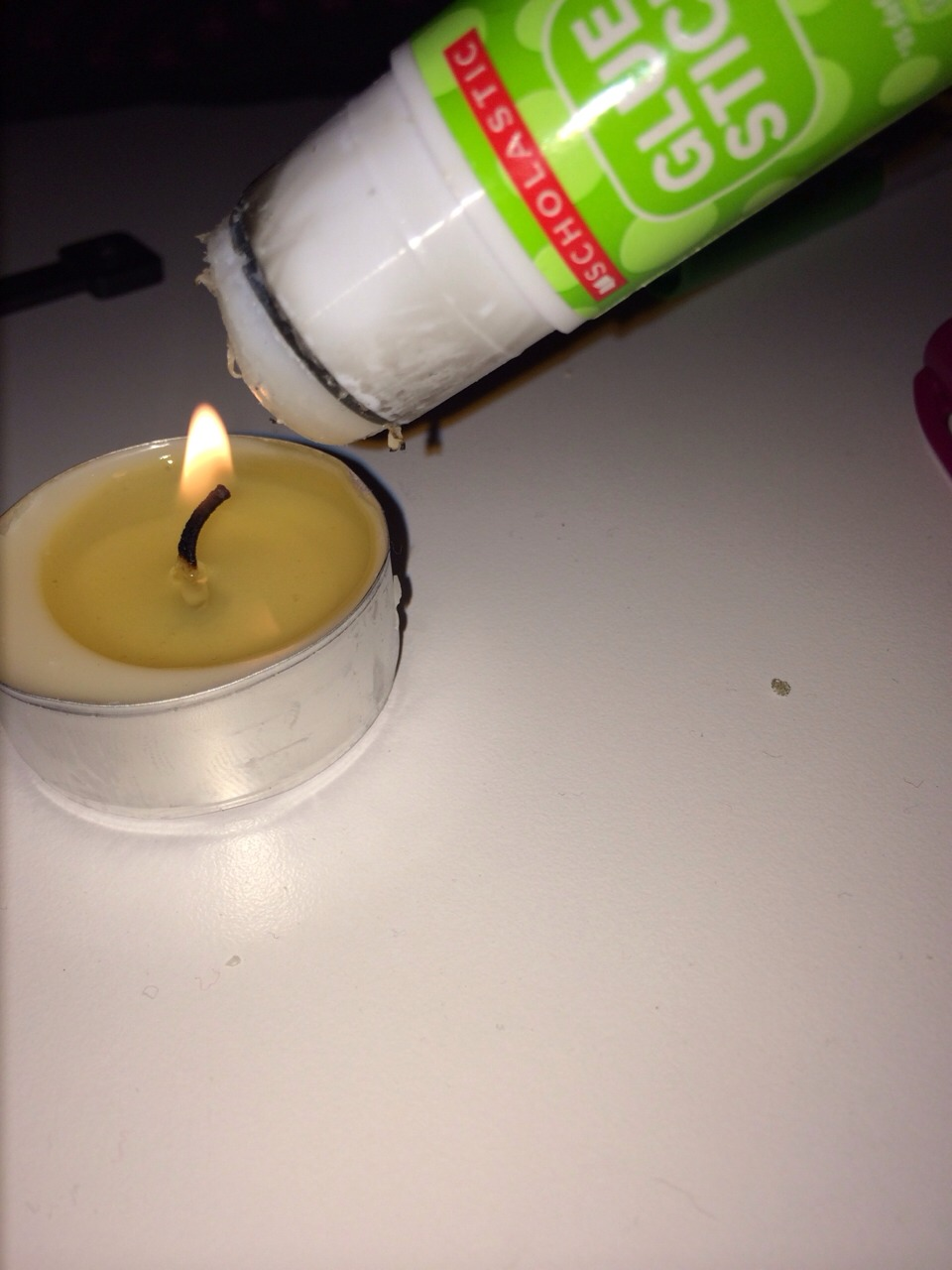 Place glue stick over a flame for 5-10 seconds.