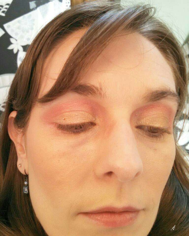 You just need two products to create this look- a gold eye shadow, and a pinkish red/orange eye shadow.