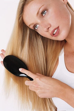 2. After shampooing, conditioning, and towel drying, stand/sit in a warm, preferably sunny area and brush your hair straight down. Do this until it's totally dry. Try a hair brush made for wet hair.