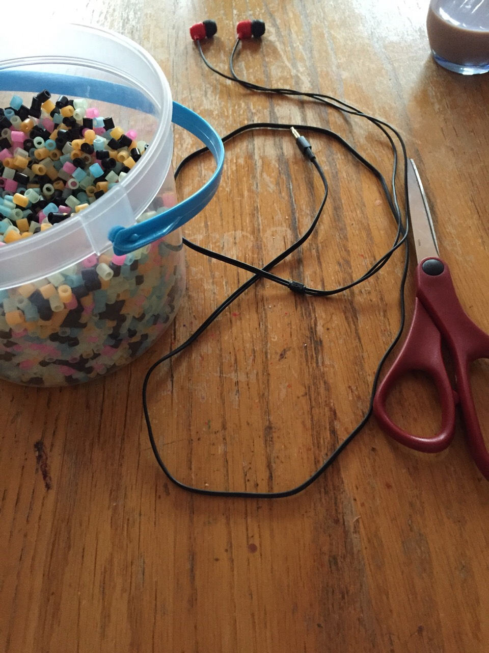What you'll need is  Headphones Plastic beads Scissors  Time 1+ hour