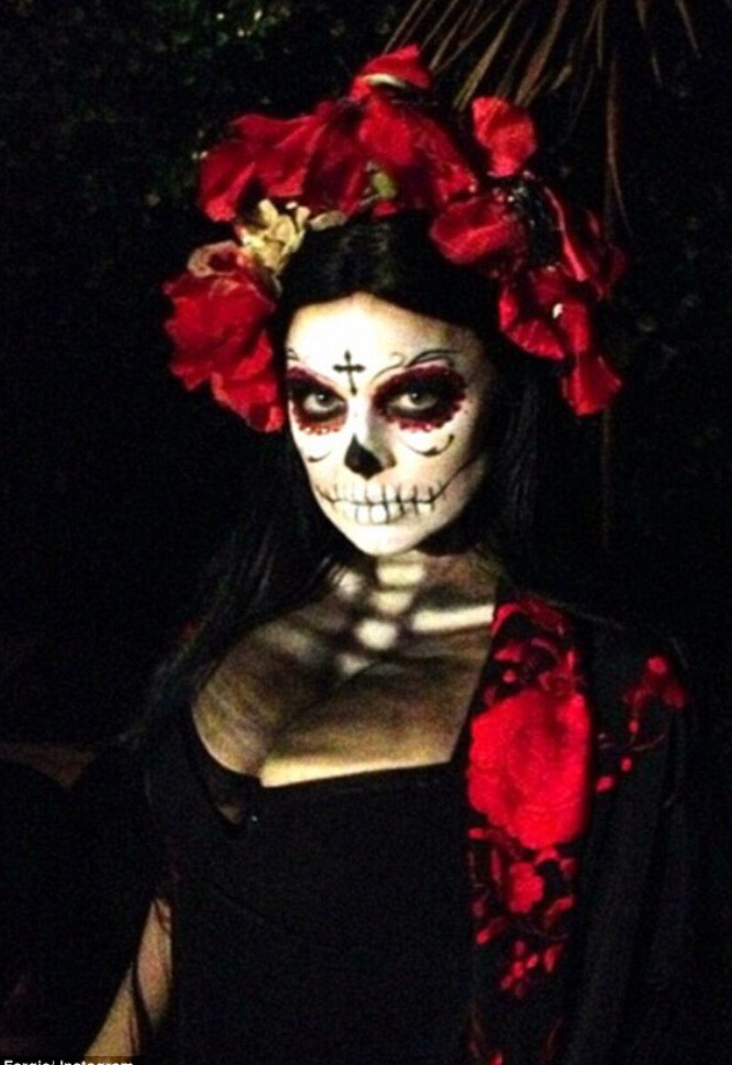 If you're looking to do-up your makeup, Day of the Dead makeup with a colorful and festive dress is lovely 😍