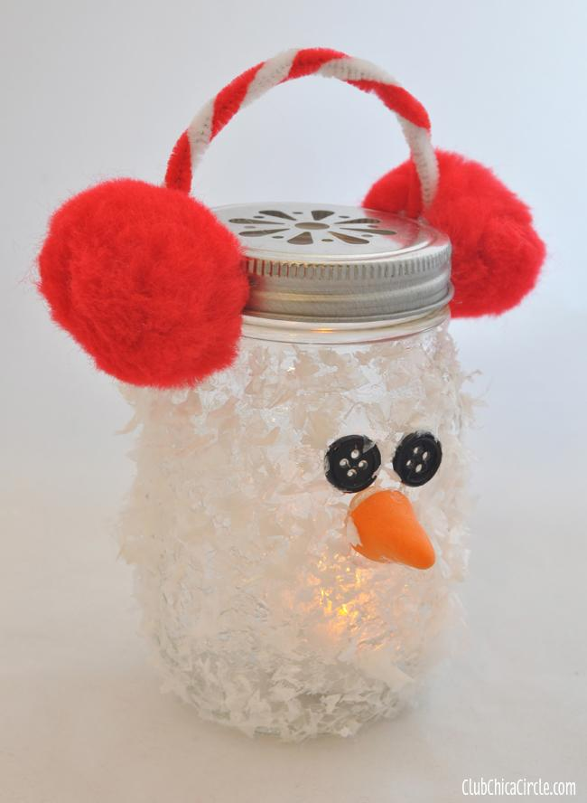 Place your earmuff decorated lid on the top of your dried snowman mason jar, and you are finished!  Add a battery-operated candle light to make it glow.