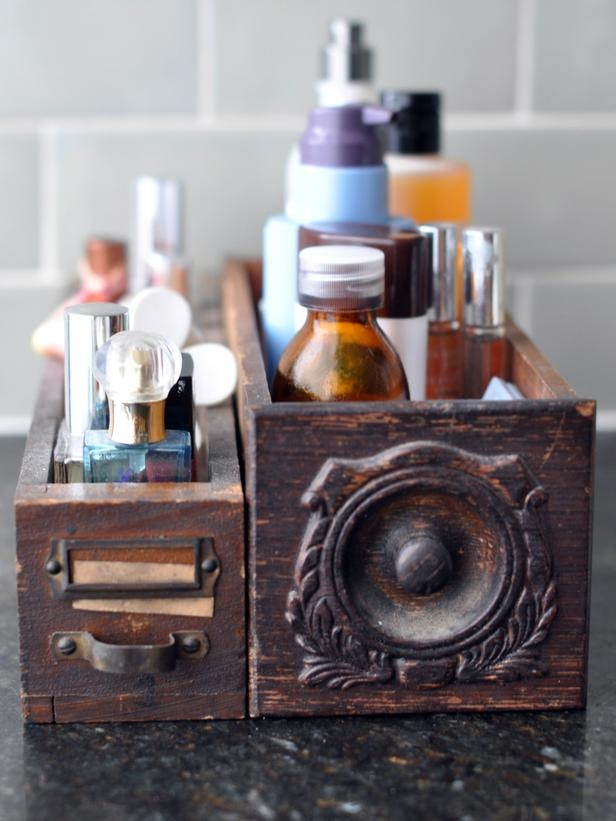In an Hour: Gain Instant Bathroom Storage Here, mismatched vintage dresser drawers store the scourge of bathroom counters everywhere: makeup and hair products.