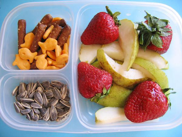mixed fruit salad, crackers, nuts and seeds