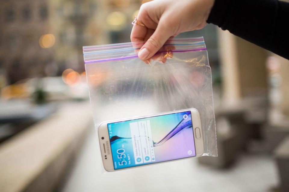 2. Stick your phone in a plastic sandwich bag to prevent it from getting ruined. You'll still be able to access the buttons through the bag, and the plastic will protect it from sweat, dirt, mud, etc.