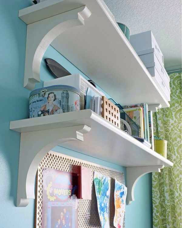 28. For a cheap and classy alternative to bookshelves, use stair treads and corbels.