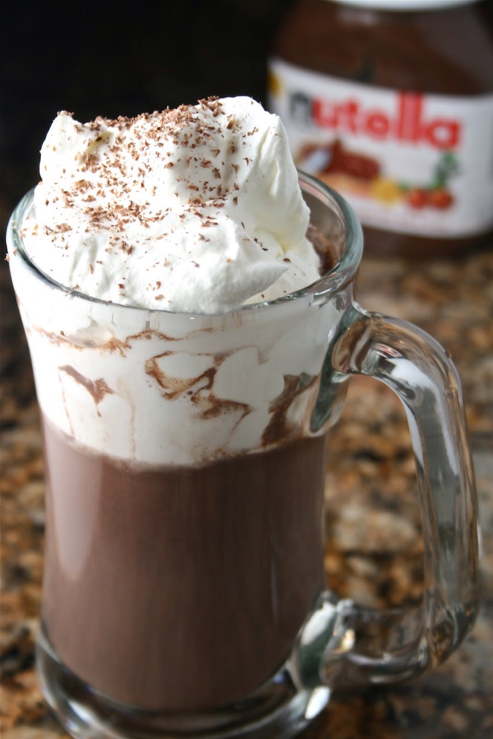 Put one cup of milk and one spoonful of Nutella in a mug.