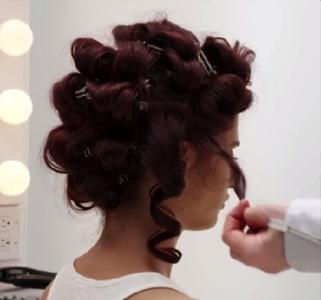 (9) Continue curling the rest of your hair and pinning horizontally on your head. When finished gently unravel the curls.  (10) Work a wide panel brush through your hair until you reach desired shape. (11) Sick the lower side of your down and secure with bobby pins.