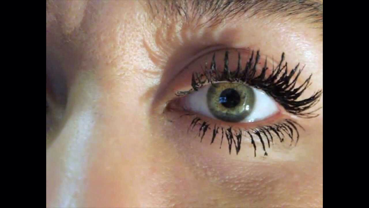 Hold your bottle of mascara (closed) under warm water for about a minute. It should come off a lot more smooth and less clumpy!:)