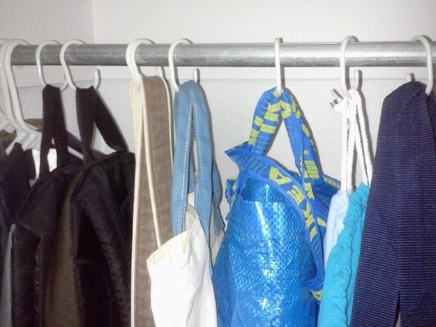 Hang bags up with shower curtain rings and keep random stuff in them.You could have one bag for underwear, one for socks, etc.