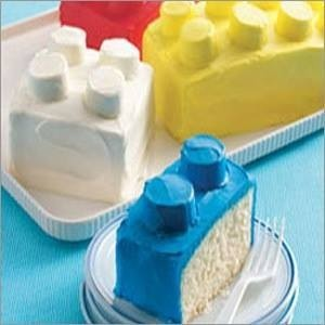 Bake cake. Make into different size squares. Ice with bright colored icing. Ice marshmallows with bright colored icing and add on top.