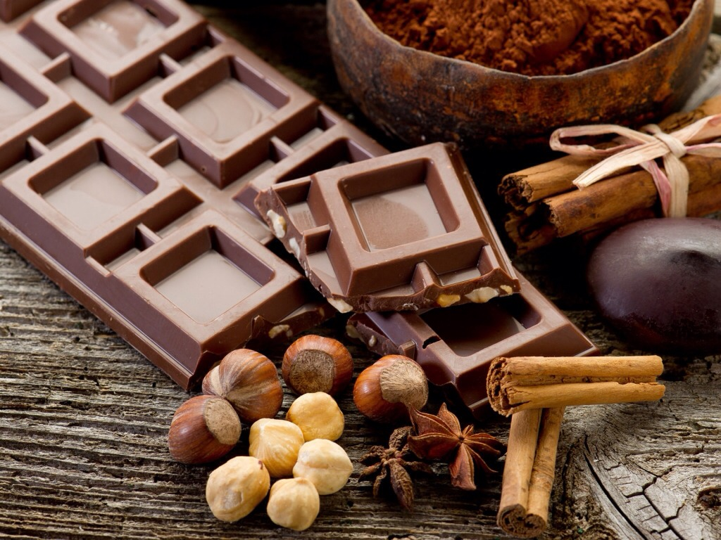 Counteract the waist expanding sugar in chocolate with a handful of nuts the protein keeps the sweet stuff on check so you don't end up on a blood sugar roller coaster