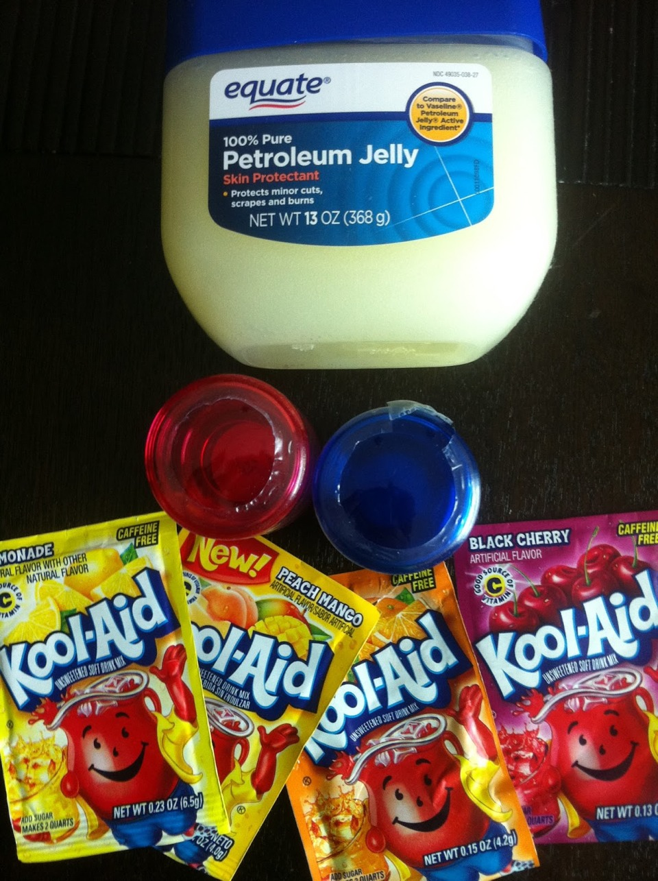 Kool aid lip balm:   take as much Vaseline as you like and heat in 30 second increments stirring in between. Continue to do this until Vaseline is completely liquid. IT WILL BE HOT. Stir in kool aid until desired colour. Reheat if it solidifies. Let cool 2 hours before using.