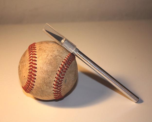 Photo tutorial at: http://kittycotten.com/2011/11/baseball-bracelet-diy.html