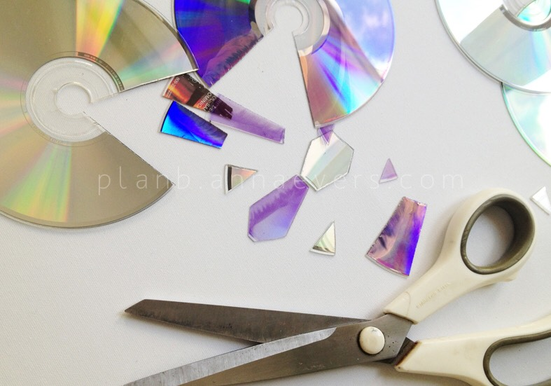 3. Cut CD's creating a composition with identical shapes in pairs or if you prefer all into small pieces with random order.