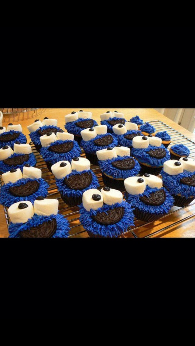 Bake your cupcakes and then apply your blue frosting. Place two large marshmallows on top. Along with a brown m&m. Place half an Oreo for the mouth!
