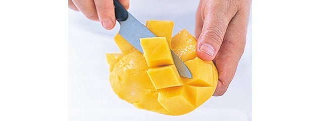 Interestingly enough, when you search for how to cut a mango, almost every single article shows a different technique that involves cross-hatching the mango flesh while it's still inside the skin and then cutting it out in cubes. After watching This way of doing it I think it's MUCH easier!