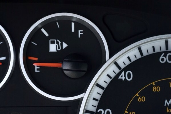 Don't want to drive up to the pump the wrong way? Check your gas gauge. You'll find a small arrow that points to the side the fuel door is on.