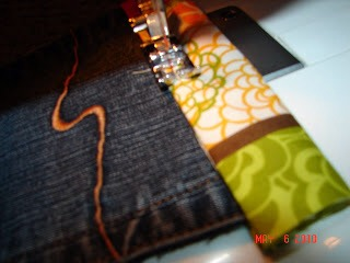 12.This extra fabric gets tucked under when I sew. I just sew it all the way around. WHen I get to the edges…. I turn it wrong side out and sew