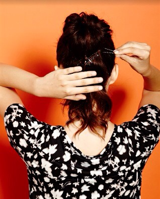Take the loose hair and pin the center of the tail to the back of your head with lots of criss cross bobby pins.