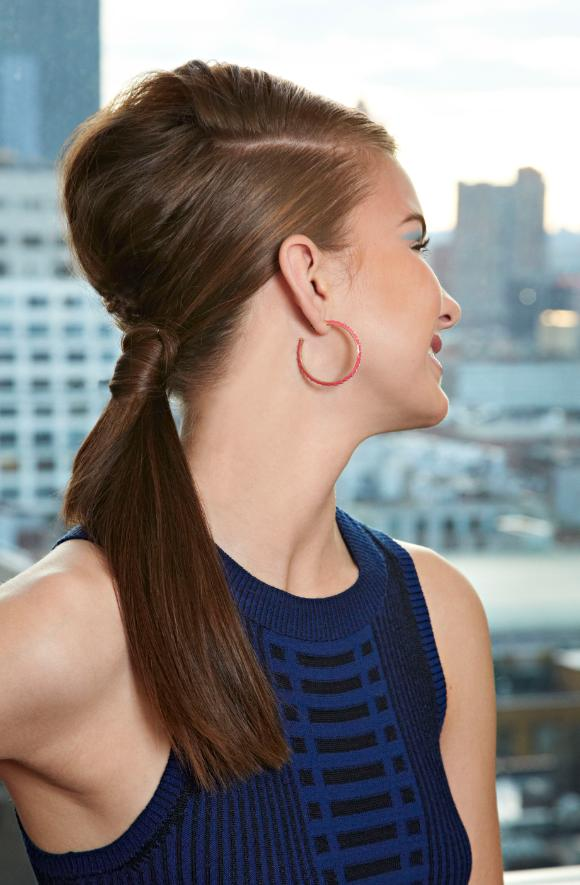 8. Tease your crown before pulling your hair back for a modern bouffant.