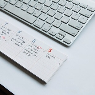24. Sticky-Note Desk Calendar, $10  It's a pad of paper that doubles as a keyboard wrist pad, and you can stick it anywhere you'd like as a reminder or agenda planner.