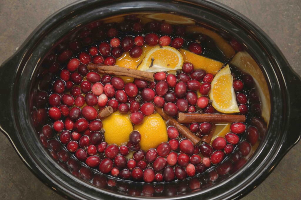 In your crockpot Take a bag of cranberry a few cinnamon sticks , 2 lemons cut up , 2 oranges cut up , 1 vanilla bean and 3 quarts water.  Simmer and watch how amazing your house smells. I just did this yesterday and I love it!!